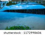 overflow of tha chomphu dam in...   Shutterstock . vector #1172998606