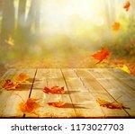 autumn maple leaves on wooden ...   Shutterstock . vector #1173027703