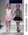 NEW YORK - OCTOBER 21: Girls walk runway petite Parade by Ooh! La, La! Couture during kids fashion week sponsored by Vogue Bambini, Swarovski Elements at Industria Superstudio on Oct 20, 2012 in NYC - stock photo