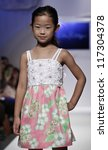 NEW YORK - OCTOBER 21: Girl walks runway for petite Parade show by Lilly Pulitzer during kids fashion week sponsored by Vogue Bambini, Swarovski Elements at Industria Superstudio on Oct 21 2012 in NYC - stock photo