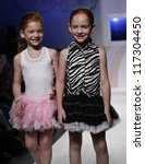 NEW YORK - OCTOBER 21: Girl walks runway petite Parade by Ooh! La, La! Couture during kids fashion week sponsored by Vogue Bambini, Swarovski Elements at Industria Superstudio on Oct 20, 2012 in NYC - stock photo