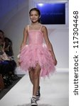 NEW YORK - OCTOBER 21: Girl walks runway petite Parade by Ooh! La, La! Couture during kids fashion week sponsored by Vogue Bambini & Swarovski Elements at Industria Superstudio on Oct 20, 2012 in NYC - stock photo