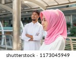 muslim woman is standing with... | Shutterstock . vector #1173045949