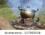 preparing food on campfire in... | Shutterstock . vector #117305518