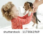 child with dog  | Shutterstock . vector #1173061969