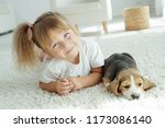 child with dog | Shutterstock . vector #1173086140