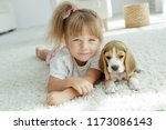 child with dog | Shutterstock . vector #1173086143