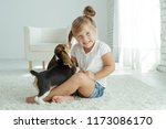 child with dog | Shutterstock . vector #1173086170