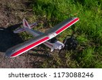 red and white rc plane out of... | Shutterstock . vector #1173088246
