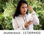 distressed singaporean young... | Shutterstock . vector #1173094420