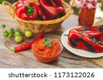 served ajvar on table with red... | Shutterstock . vector #1173122026