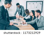 multicultural businesspeople... | Shutterstock . vector #1173212929