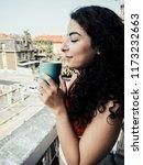 brunette model drinking coffee... | Shutterstock . vector #1173232663