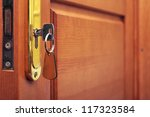 key in keyhole with blank label | Shutterstock . vector #117323584