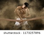 determined karate man breaking... | Shutterstock . vector #1173257896
