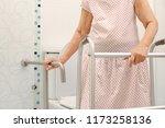 elderly woman holding on... | Shutterstock . vector #1173258136