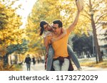 young student couple making fun ... | Shutterstock . vector #1173272029