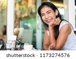 happy middle aged asian woman... | Shutterstock . vector #1173274576