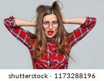 a frightened young woman in... | Shutterstock . vector #1173288196