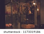 meat products in a dimly lit... | Shutterstock . vector #1173319186