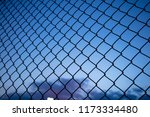 dark blue sky through wire mesh ... | Shutterstock . vector #1173334480
