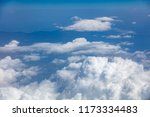 white fluffy clouds background... | Shutterstock . vector #1173334483