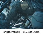 biker in leather gear riding a... | Shutterstock . vector #1173350086