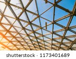 ceiling glass roof in sunset sky | Shutterstock . vector #1173401689