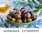 assortment of fresh olives on a ... | Shutterstock . vector #1173405919