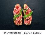 bruschetta with prosciutto ... | Shutterstock . vector #1173411880