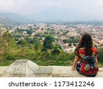 a young female tourist admiring ... | Shutterstock . vector #1173412246