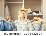 girl near a wardrobe with... | Shutterstock . vector #1173432829