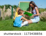 mathematics lesson on open air | Shutterstock . vector #1173438856