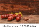 grilled sausages on wooden... | Shutterstock . vector #1173459496