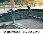 young woman jumping on steel... | Shutterstock . vector #1173557890