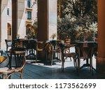 cozy outdoor cafe with empty... | Shutterstock . vector #1173562699