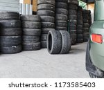 used car tires stacked in piles ...   Shutterstock . vector #1173585403