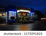 Small photo of Bennington, VT, USA October 15, Twilight starts to glow behind the Blue Benn Diner, a classic railcar diner in Bennington, Vermont