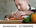chef slicing salmon for cooking ... | Shutterstock . vector #1173604096