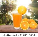 orange  on white a wooden table | Shutterstock . vector #1173610453