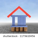 house on a pile of coins money | Shutterstock . vector #1173610456