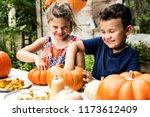 Young Kids Carving Halloween...