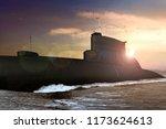 Naval submarine at sea during...