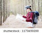 young woman carry a backpack... | Shutterstock . vector #1173650200