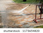 outdoor floor cleaning with a... | Shutterstock . vector #1173654820