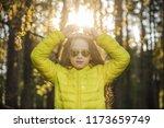 little girl folded her hands a... | Shutterstock . vector #1173659749