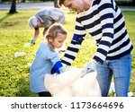 kids picking up trash in the... | Shutterstock . vector #1173664696