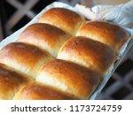 Hand Holding Hot Baking Tray O...