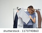 woman chooses things on her... | Shutterstock . vector #1173740863