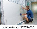 man measuring plasterboard...   Shutterstock . vector #1173744850